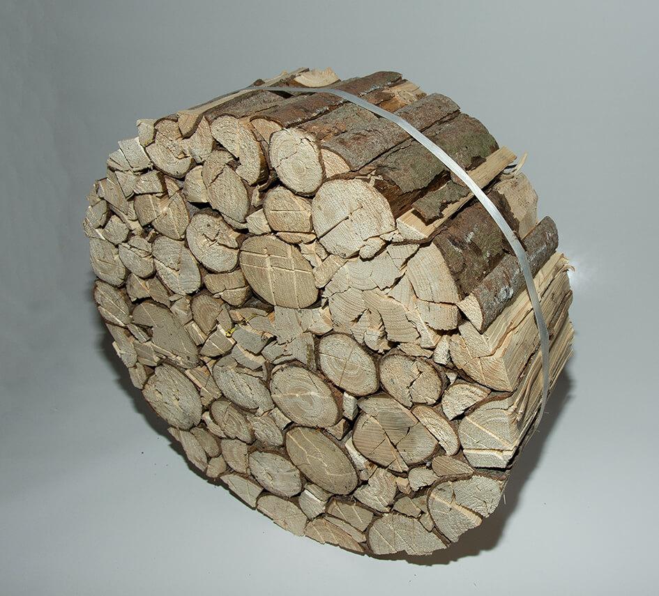 Dřevo v kolech - ilustrační foto